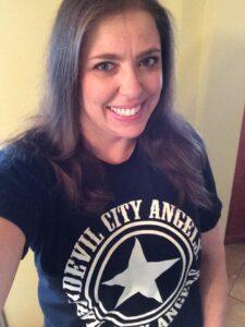 Marlene Marshall Royse proudly displaying her DCA shirt